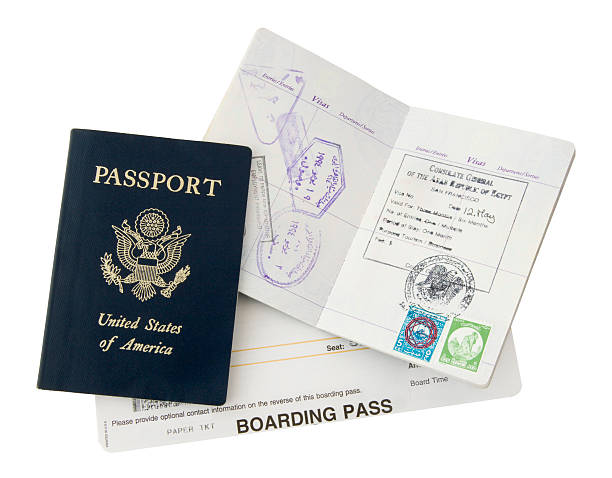 Passport and boarding pass for a trip stock photo
