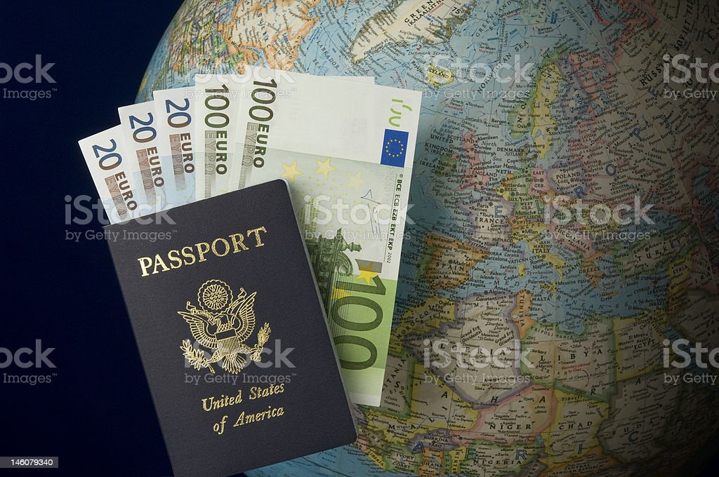 Passport and Euros with Globe in the background royalty-free stock photo