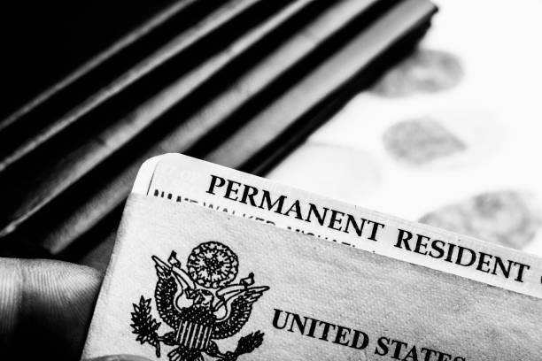 Passport and green card USA permanent resident card (Green Card) next to passports and fingerprints deportation stock pictures, royalty-free photos & images