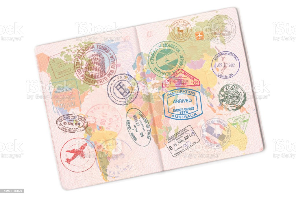 Passport and lot of stamps on it. Isolated on white background stock photo