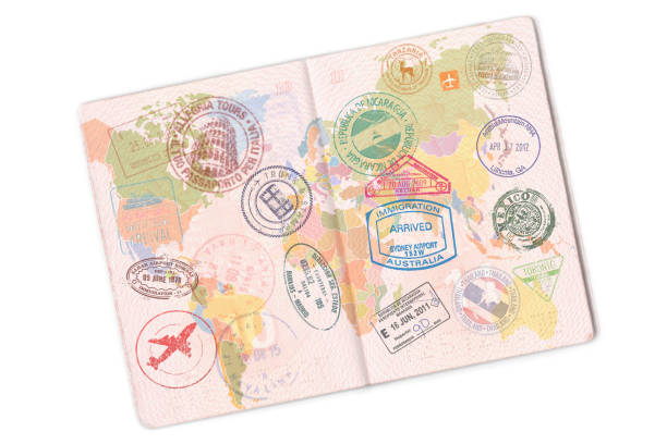 Passport and lot of stamps on it. Isolated on white background Passport and lot of stamps on it. Isolated on white background. passport stamp stock pictures, royalty-free photos & images