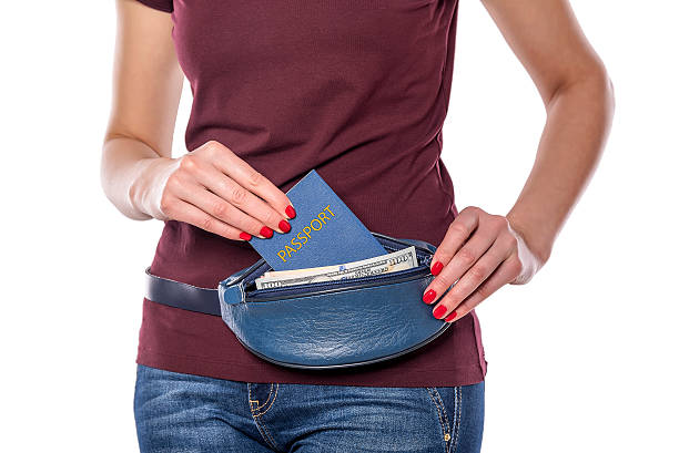 passport and money in the mobile bag - waist bag stock photos and pictures