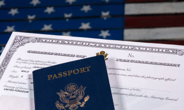 usa passport and naturalization certificate over us flag - citizenship stock photos and pictures