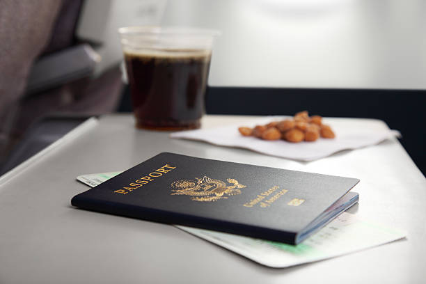 passport and peanuts - gchutka stock pictures, royalty-free photos & images