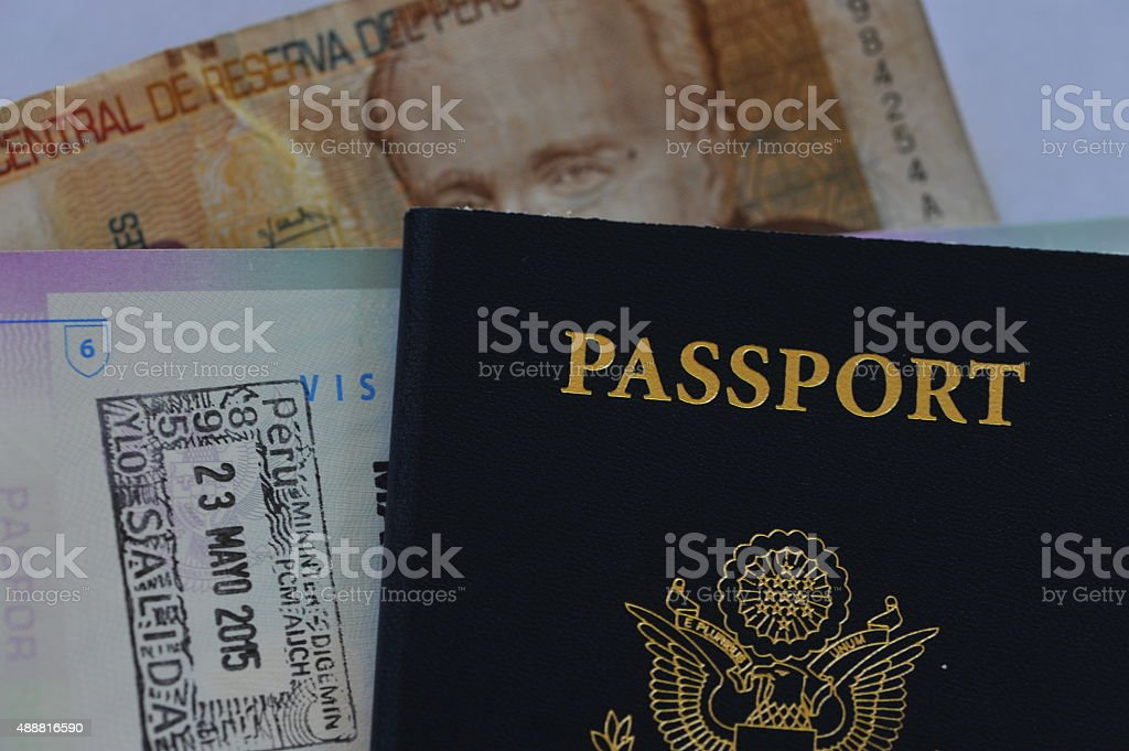 US Passport and Peruvian Visa Stamp and Sol Currency stock photo