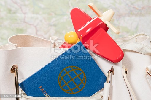 istock passport and plane in pocket of bag 1061426356