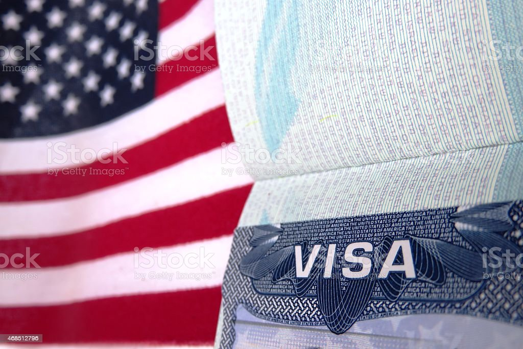Passport book with Visa paper open on red and white stripes Visa  2015 Stock Photo
