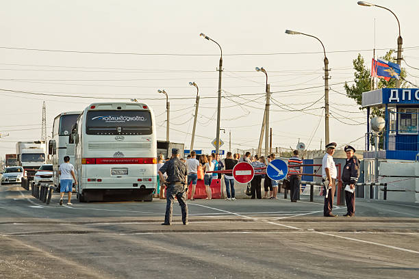 passport control all intercity buses Volgograd, Russia - August 9, 2015: Passengers intercity buses pass security and passport control at a checkpoint the police. Police inspect the Luggage in the bus. antiterrorist stock pictures, royalty-free photos & images