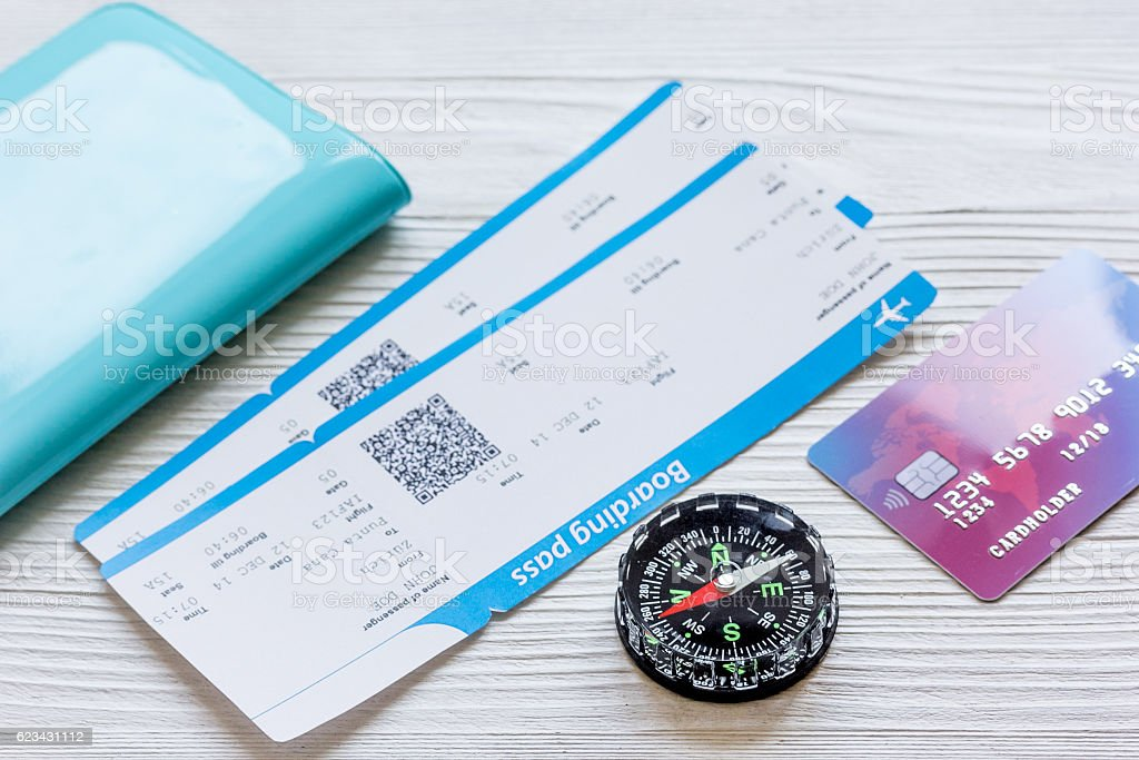 passport, credit card, tickets on wooden background - Photo