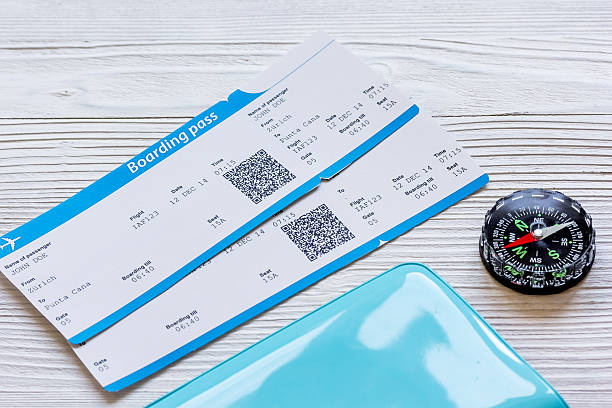 passport, credit card, tickets on wooden background - aeroplane ticket stock photos and pictures