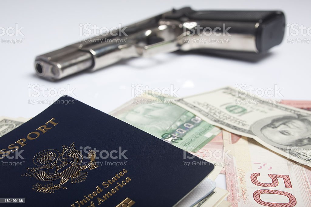 USA passport dollar bills and gun royalty-free stock photo