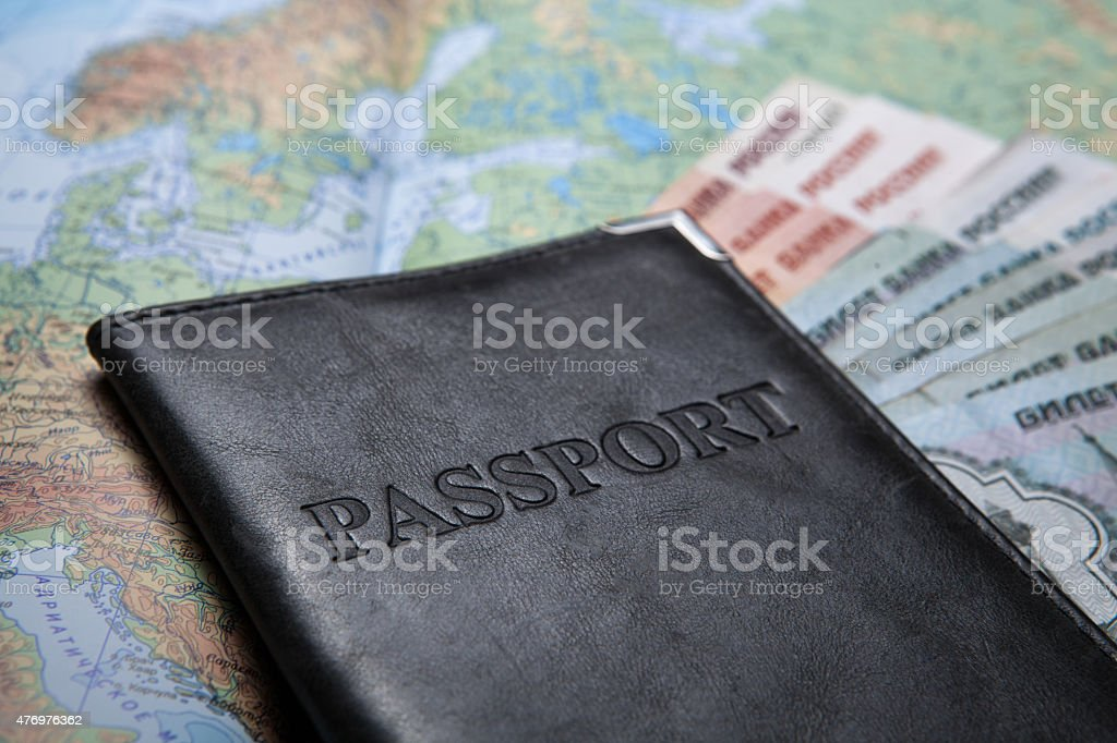 passport in the bag on a map with bank notes stock photo