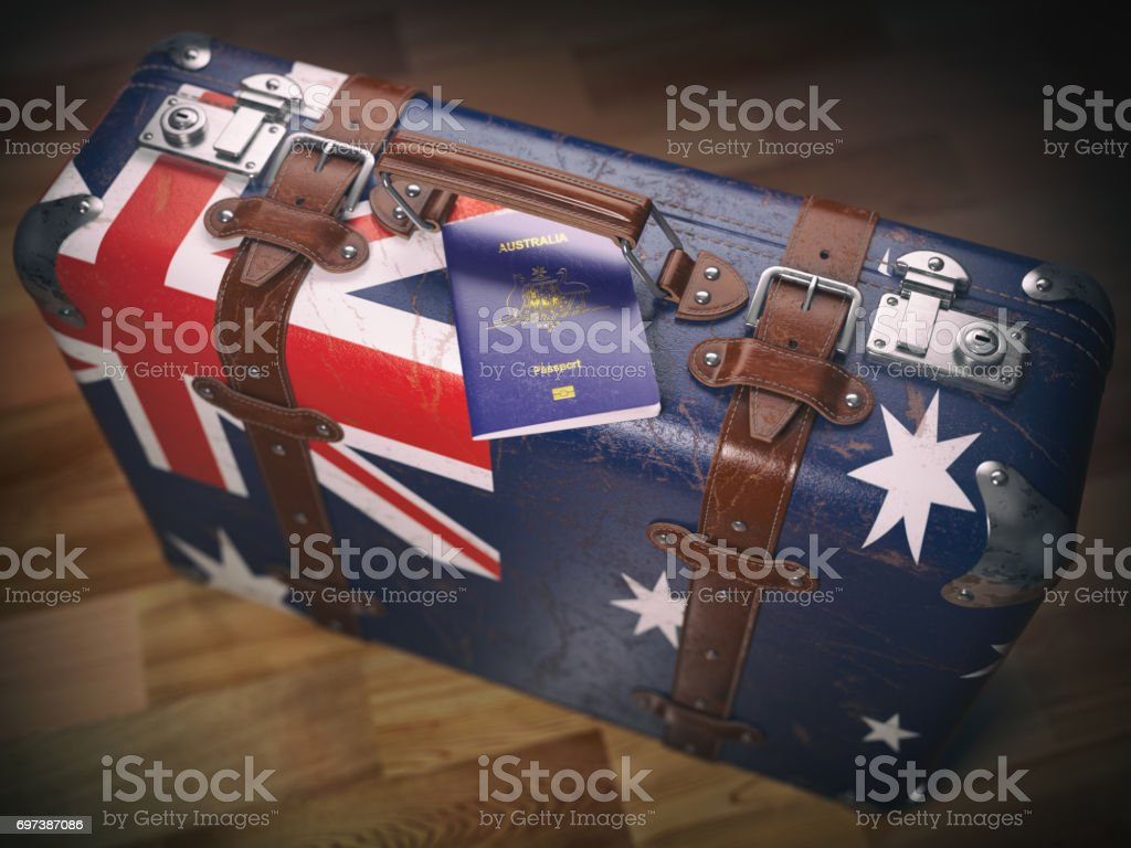 Passport of Australia and suitcase with flag of Australia. stock photo
