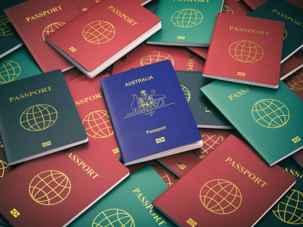 passport of australia on the pile of different passports. immigration concept. australian passport. - citizenship stock photos and pictures