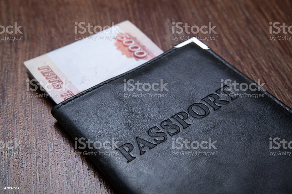 Passport on a table with paper money stock photo