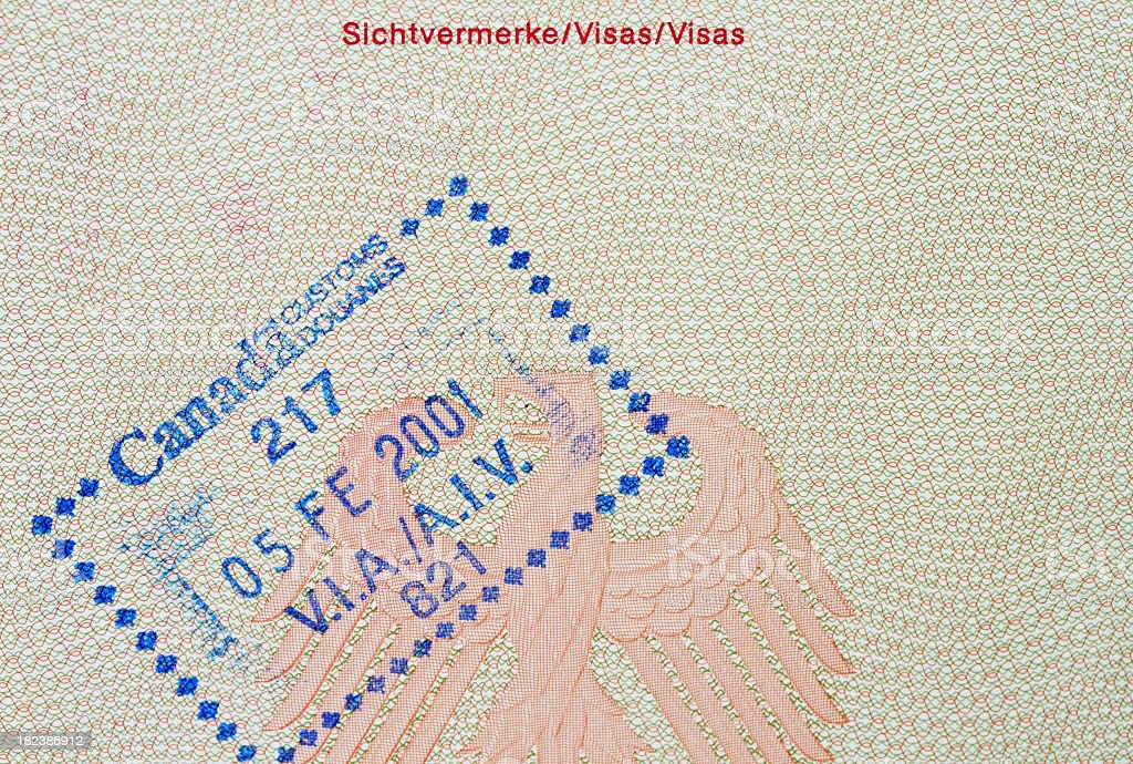 Passport Page with Canada Immigration Entry Stamp stock photo