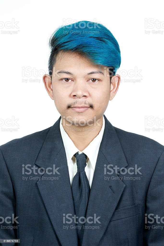 passport photo of young attractive asian man with blue hair stock photo