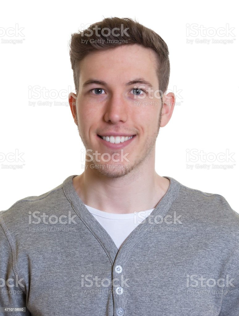 Passport picture of a laughing guy in a grey shirt stock photo