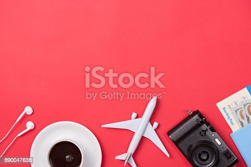 istock Passport, plane model and camera on red background. 890047638