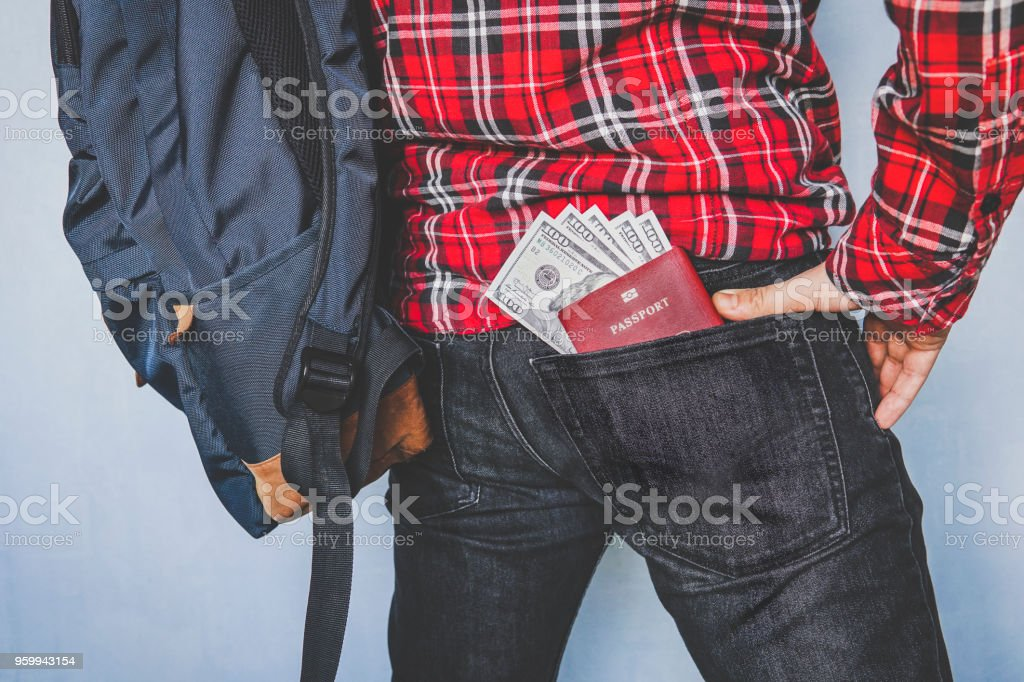 passport showing in back pocket of jeans stock photo