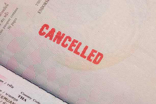 Passport Stamp Cancelled Passport Stamp Cancelled pasport malaysia stock pictures, royalty-free photos & images