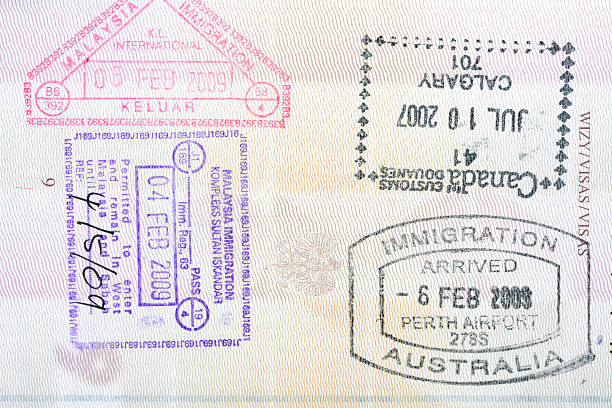 Passport stamps Stamps from Canada, Australia, Malaysia in a Polish passport pasport malaysia stock pictures, royalty-free photos & images