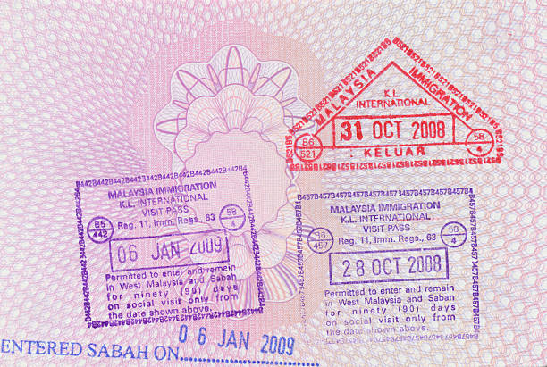 Passport Stamps Passport Stamps of Malaysia & Sabah on British PassportFor more passport images please visit the lightbox below pasport malaysia stock pictures, royalty-free photos & images
