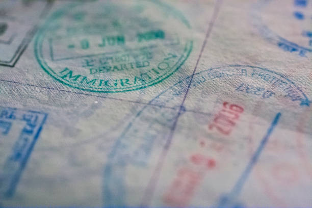 passport stamps - emigration and immigration stock photos and pictures