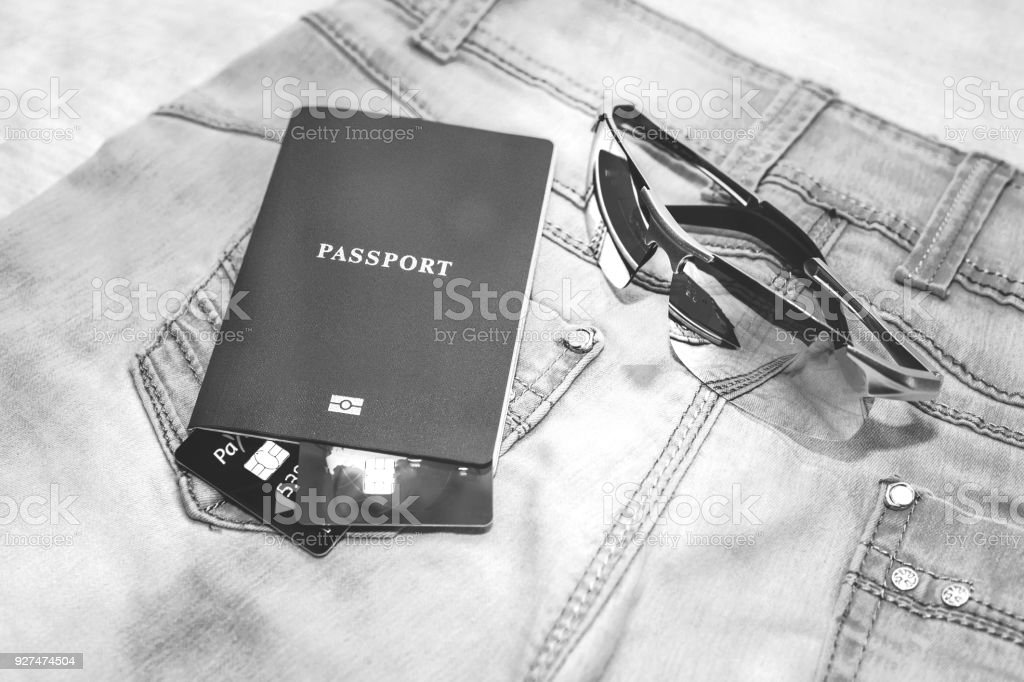 Passport with bank cards, glasses and seashells. The concept of travel. stock photo