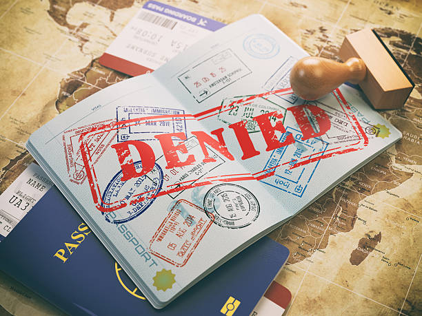 Passport with denied visa stamp on map of the world Passport with denied visa stamp on the map of the world and airline boarding pass tickets..Travel concept. 3d illustration rejection stock pictures, royalty-free photos & images