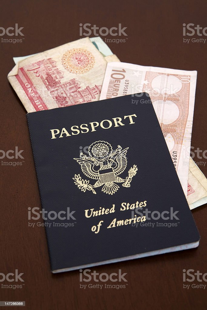 passport with euro and dinar royalty-free stock photo