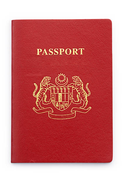 Passport with Microchip A new malaysia passport with imbedded microchip on isolated white background. with clipping path pasport malaysia stock pictures, royalty-free photos & images