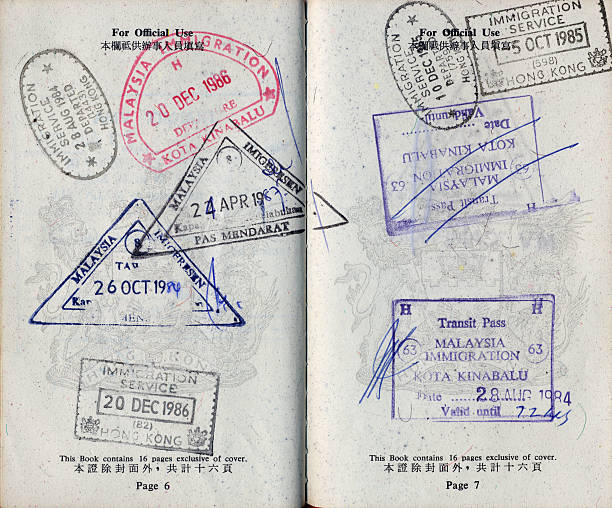 Passport with stamps Hong Kong passport with travel stamps. pasport malaysia stock pictures, royalty-free photos & images