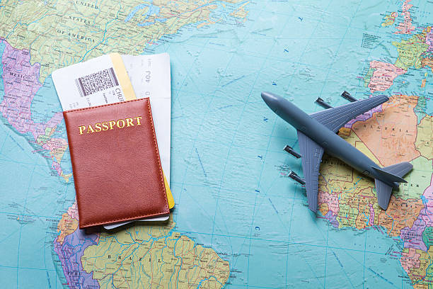 passport with tickets on map. - aeroplane ticket stock photos and pictures