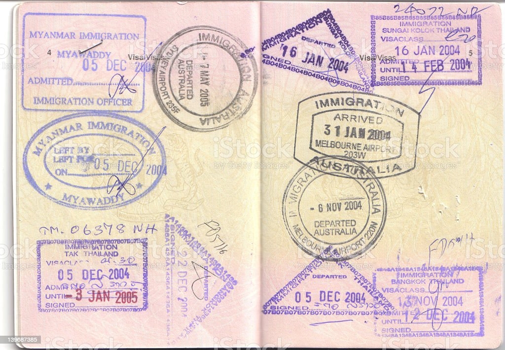 Passport with various countries stamped inside royalty-free stock photo