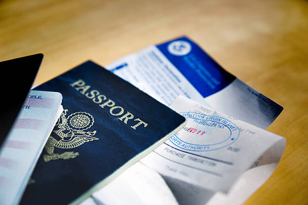 Passports and Visa Two American passports with visa or tourist cards tucked inside all stamped and ready to go.g department of homeland security stock pictures, royalty-free photos & images