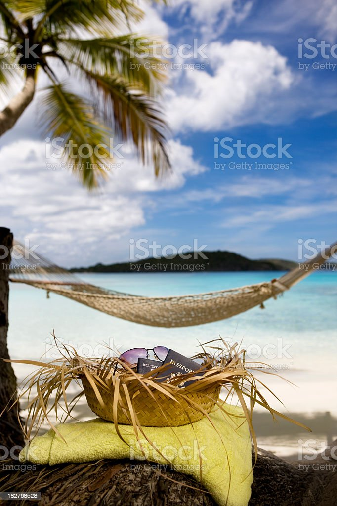 passports in a hat on tropical beach royalty-free stock photo