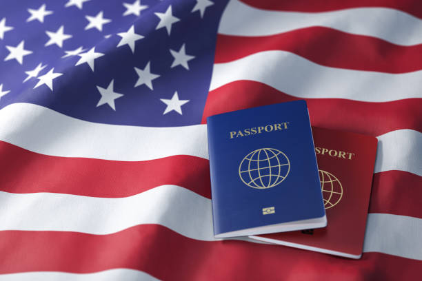 Passports on the flag of the US United Stetes. Getting a visa to USA ,  travel, naturalization and immigration concept. Passports on the flag of the US United Stetes. Getting a visa to USA ,  travel, naturalization and immigration concept. 3d illustration green card stock pictures, royalty-free photos & images