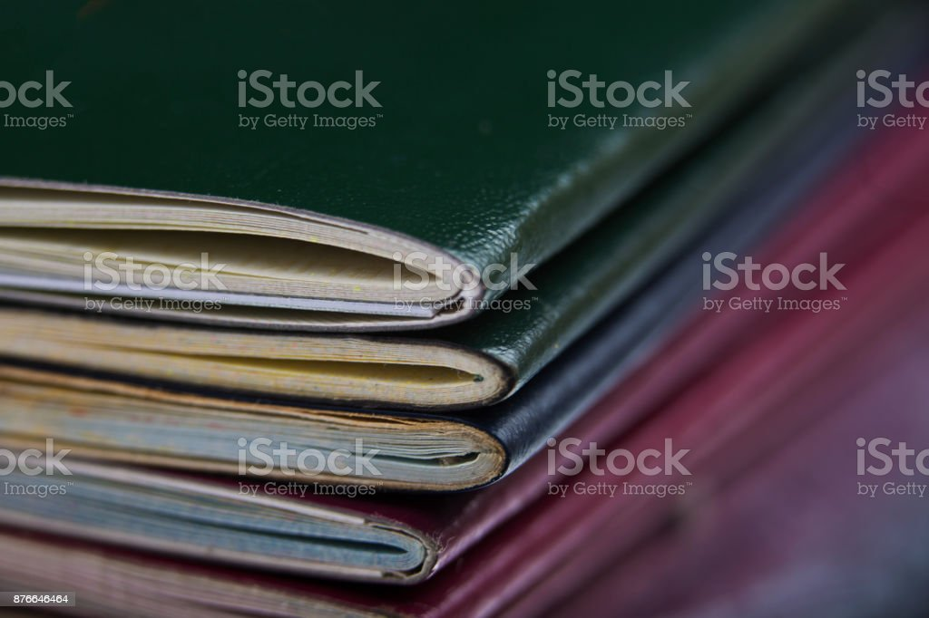 Passports stacked up on a desk at customsPassport cover stock photo
