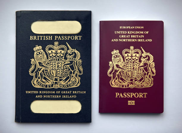 UK passports vintage and current stock photo