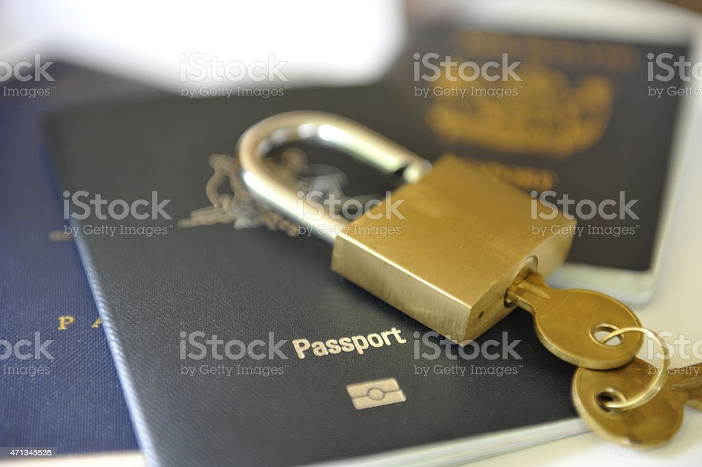 Passports with a lock and key on top stock photo