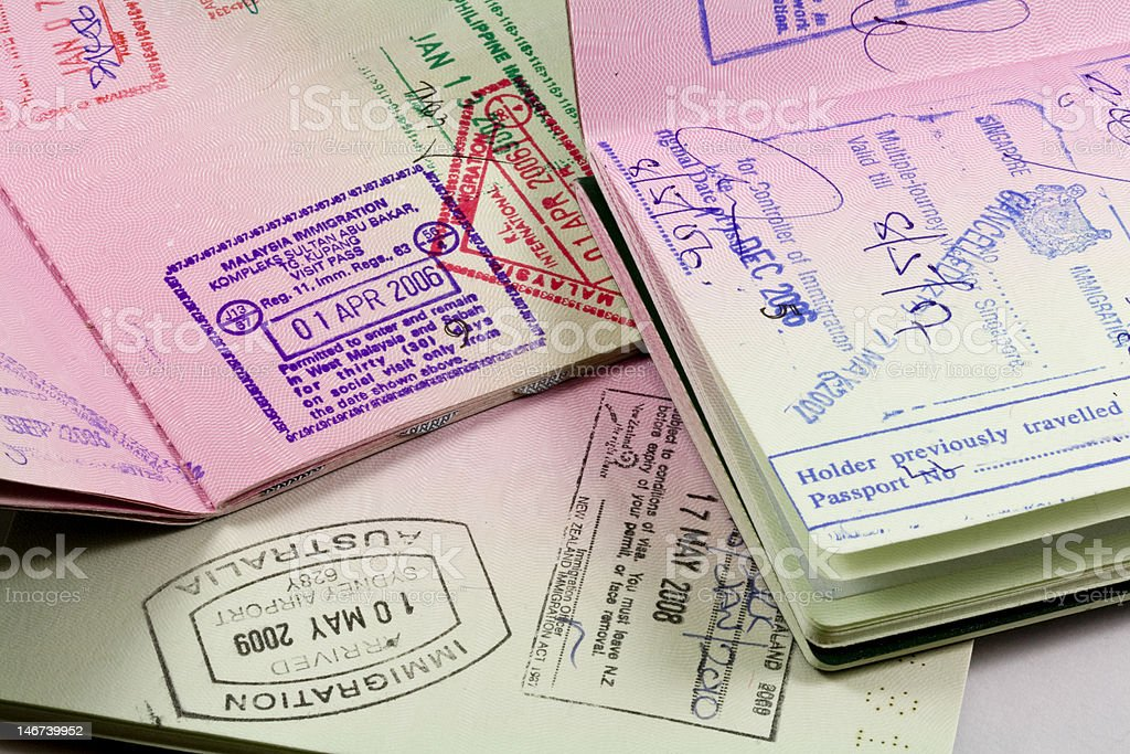 Passports with immigration stamps for Asia travel stock photo