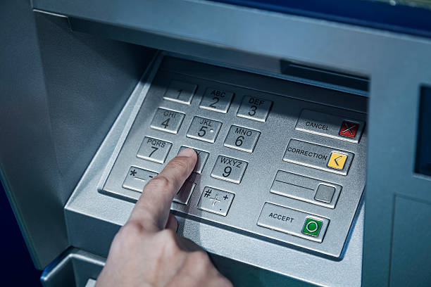 password code protection hand on button number banking automatic - bankgeheimnis stock-fotos und bilder