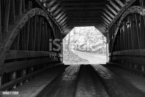 The inside of an old-fashioned covered bridge.