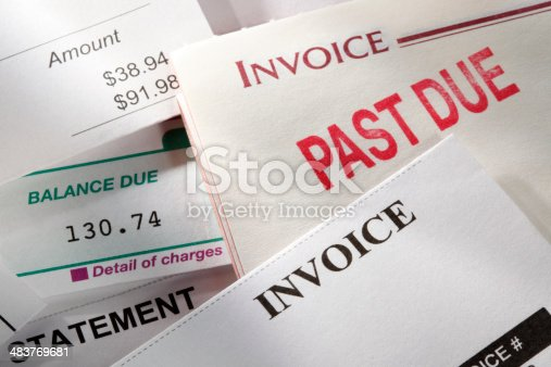 A random selection of bills or invoices with one of them stamped