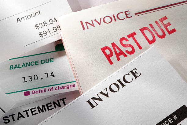past due notice stamped on an invoice - paid stock pictures, royalty-free photos & images