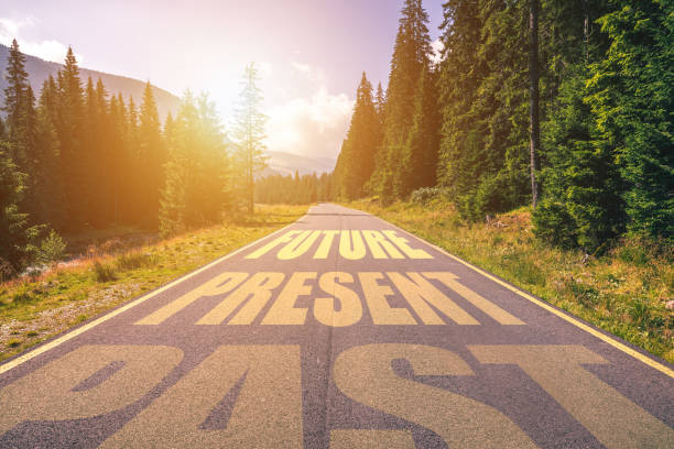 past, present, future concept. driving on an empty road in the mountains to the future passing present and leaving behind the past. - looking ahead stock photos and pictures
