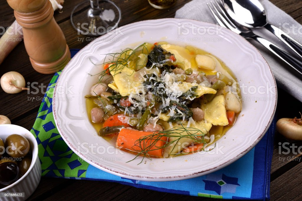 Pasta agnolotti in vegetarian soup. stock photo