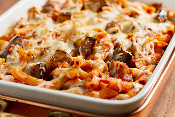 Pasta alla Norma The classic Sicilian dish made with rigatoni pasta, fresh eggplant, onion, basil, olive oil, and mozzarella cheese. rigatoni stock pictures, royalty-free photos & images