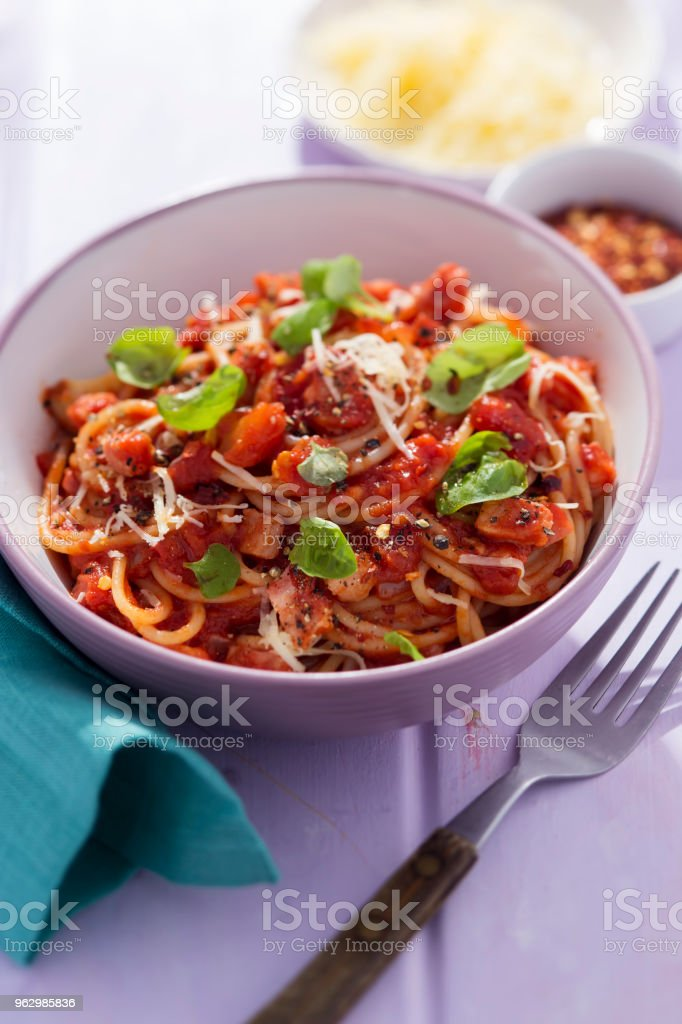 Pasta all'amatriciana with basil and parmesan stock photo